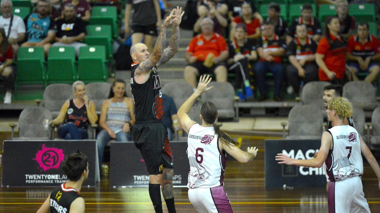 The Mackay Meteors defeated the Bundaberg Bulls 120-61 in the ConocoPhillips CQ Cup semi-final at Mackay Basketball Stadium. Brad Rasmussen shoots. Photo: Callum Dick