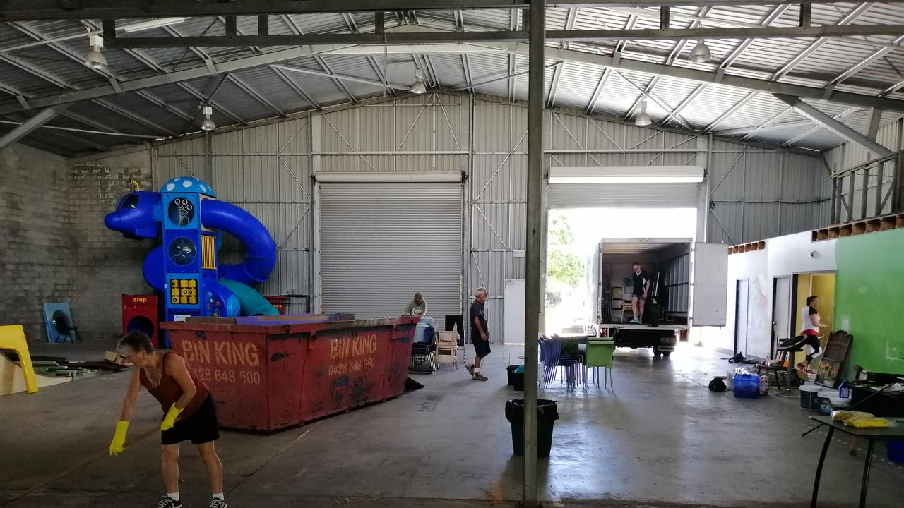 Volunteers hard at work at the working bee on Friday, setting up Hervey Bay Neighbourhood Centre's new community space.