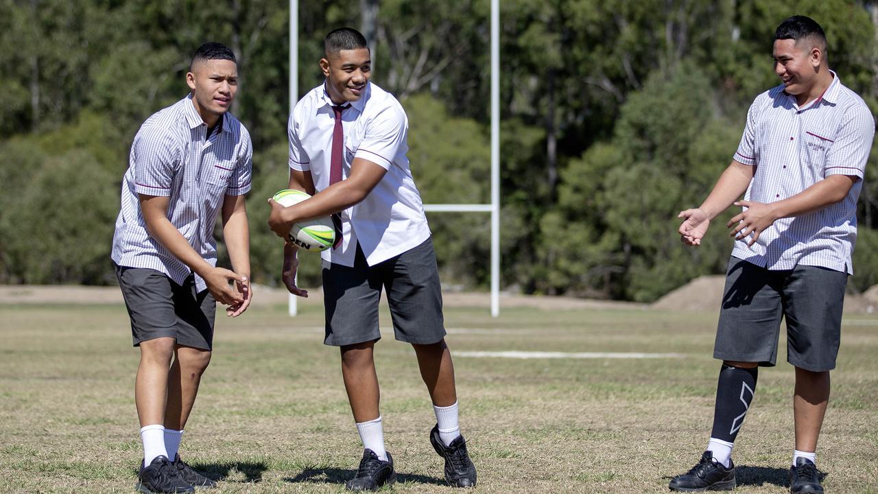 Marsden High School students ltr William Semu E.J Finau 16 and Taelon Te Whiu-Hopa are with the Titans' juniors.(Image Sarah Marshall)