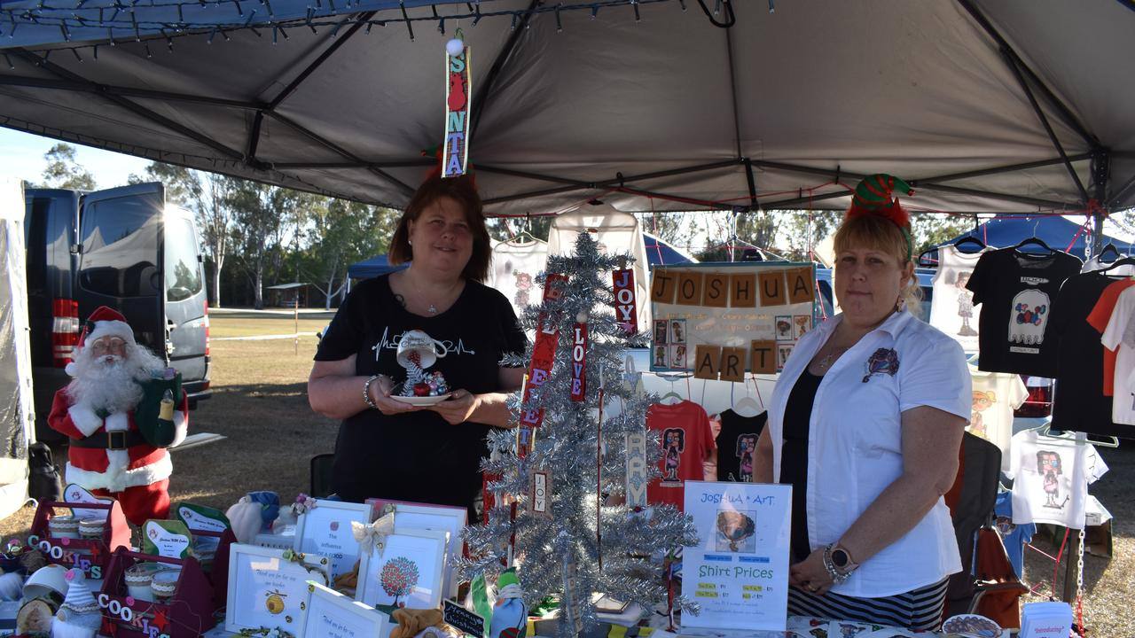(L) Kylie Drummond of Kylies Creative Christmas Creations and Vicki Dougherty of Joshua Art with their festive styled stall at the Howard Twilight Christmas Markets. Photo: Stuart Fast