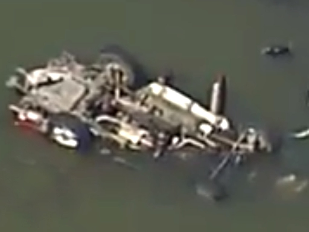 The Landrover flipped and fell upside down into Wyaralong Dam on Sunday afternoon. Picture: Channel 9