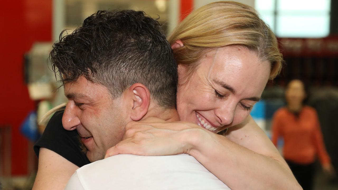 Adam de Guara embraces his partner Genevieve Wild after being apart for 5 months. Picture: NCA NewsWire / Damian Shaw