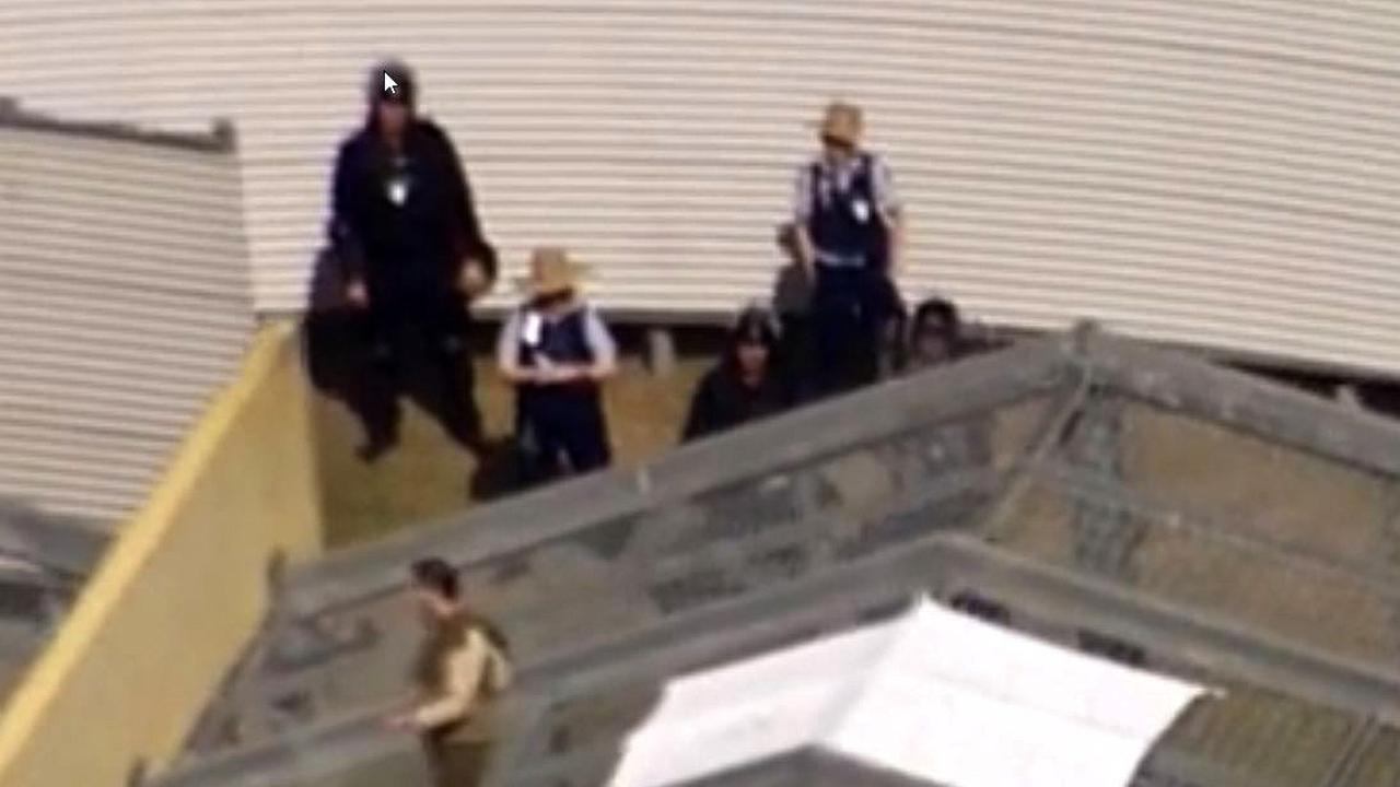 Prisoners on the roof at the high-security Wolston facility. Picture: Seven News