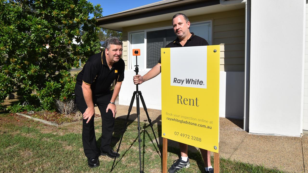 Ray White Gladstone brothers, John and Jamie Fieldus, set up for the first 3D photo shoot at one of the company's rental properties.