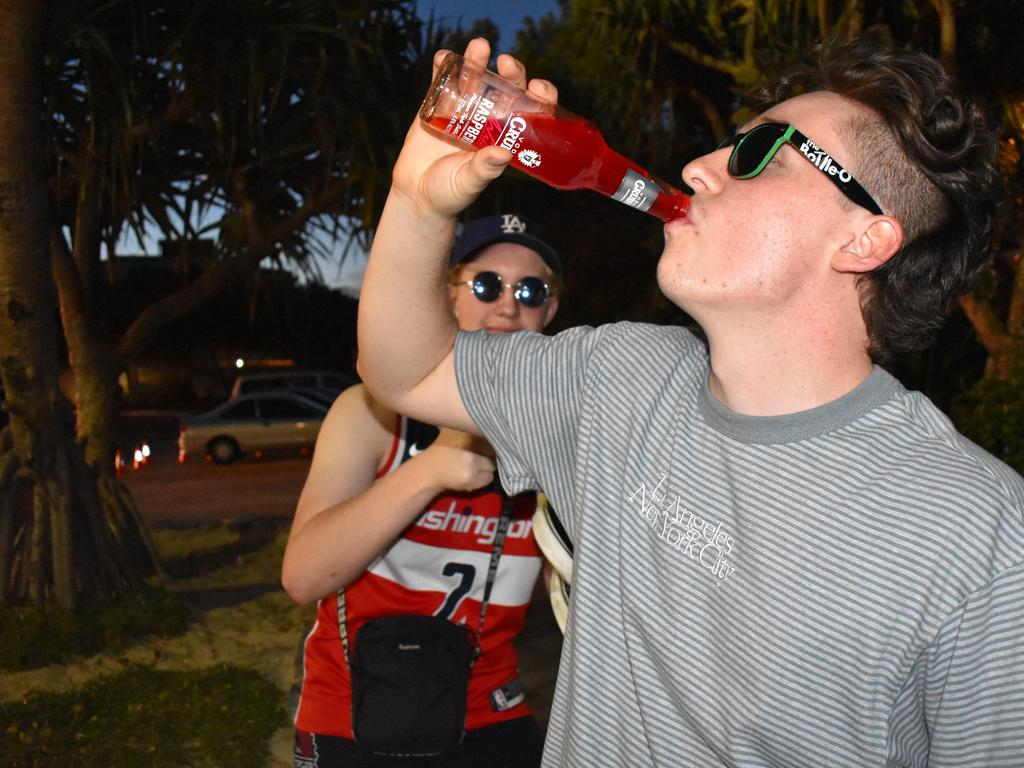 Youngster Jack Harroway does his best attempt to skol a Vodka Cruiser. Picture: Matty Holdsworth