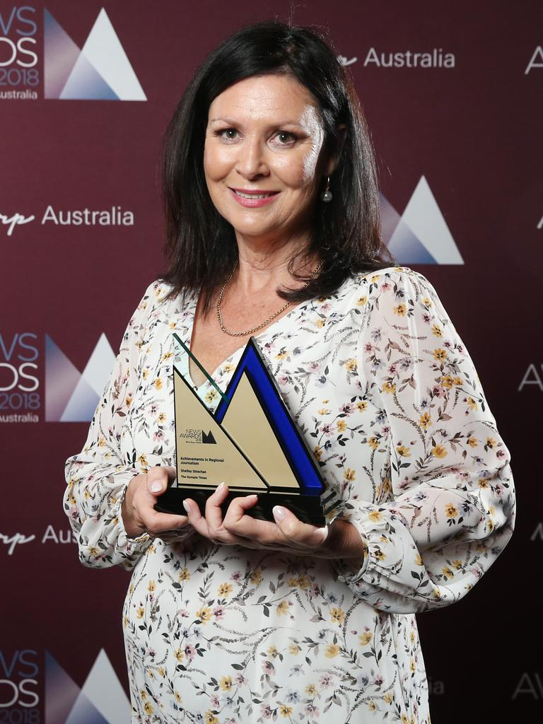 Shelley Strachan, editor of The Gympie Times, picks up the Achievements in Regional Journalism at the 2018 News Awards held at the Hyatt Regency in Sydney. Picture: Richard Dobson
