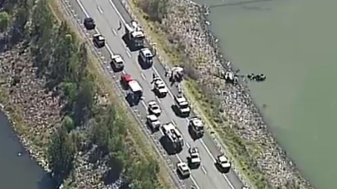 The horrific car crash halted traffic along Beaudesert-Boonah Rd as passers-by stopped and tried to help. Picture: Channel 9