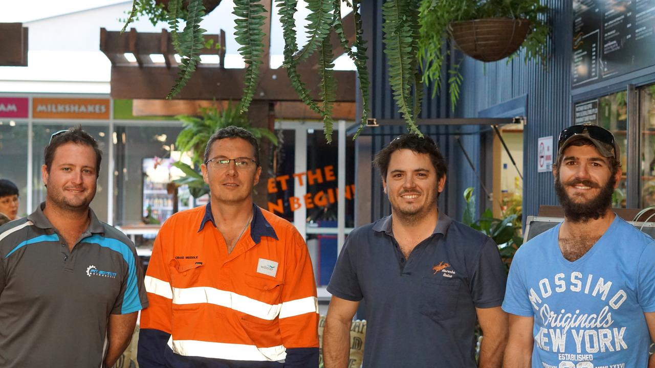 Grower and harvesting contractor Sam Orr, Wilmar's Mackay regional operations manager Craig Muddle, haul-out driver Darren Lee, and grower Owen Lee. Picture: file.