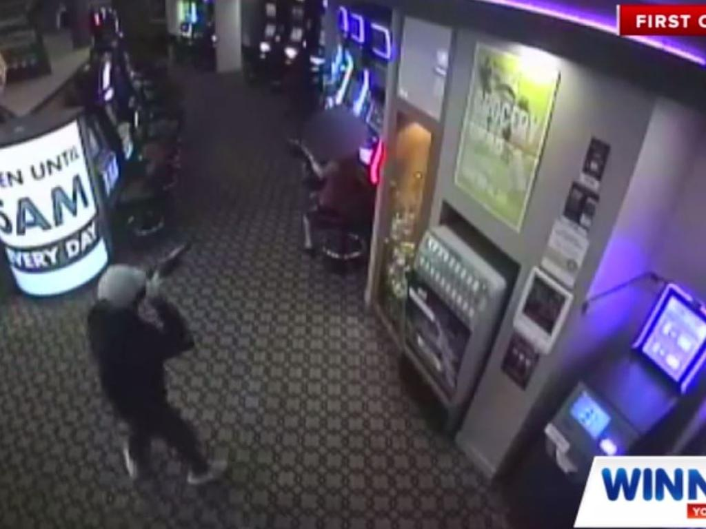 Terrifying footage of three masked gunmen stormed into the Caloundra CBX in November 2019. The trio are still at large.