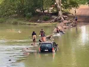 Man falls into croc-infested waters after group bogs car