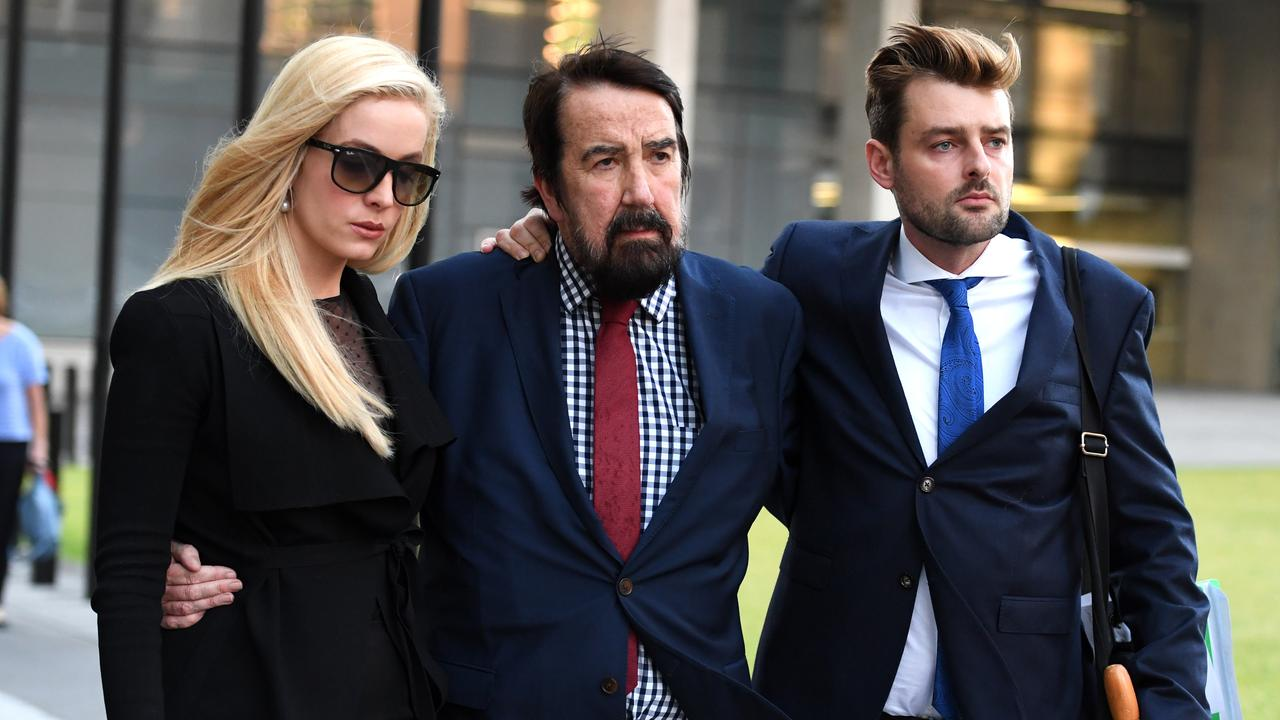 Maureen Boyce's husband Graham Boyce (centre), son Zachary Boyce and daughter Angelique Pennisi are seen leaving the Supreme Court in Brisbane in 2017. AAP Image/Dan Peled