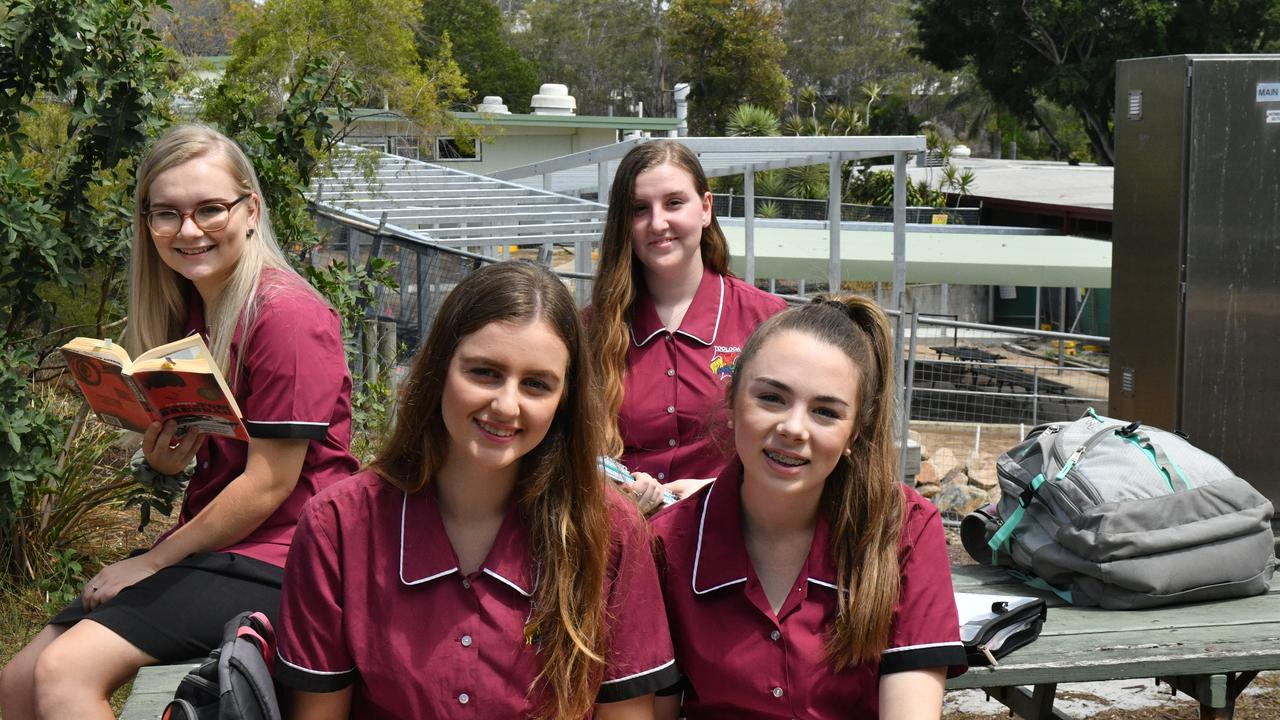 (back) Rosannah Stedman, Maddison Cambell (front) Amber Write and Brooke Assman out front Toolooa State High School's new building being constructed.