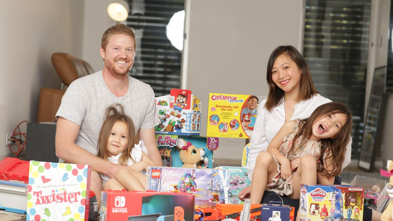 Mitch and Priscilla Sidey with their daughters Evelina (3) and Sienna Sidey (5). Picture: Christian Gilles