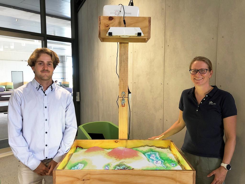 USC student Mitch Dakin and Lene Knudsen of Growcom with Mr Dakin's augmented reality sandbox. Photo: Contributed