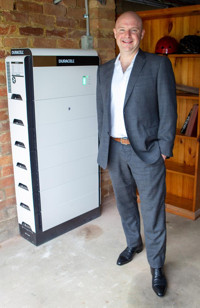 Chris Williams of Natural Solar with a Duracell battery. Source: Natural Solar
