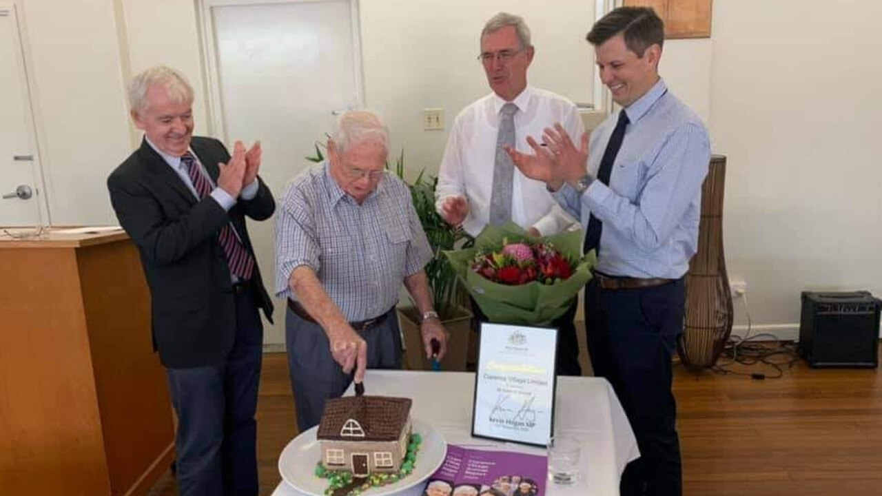 Founding chairman of Clarence Village Bill Dougherty OAM cuts the cake at the 50th anniversary celebrations of the community aged care organisation.