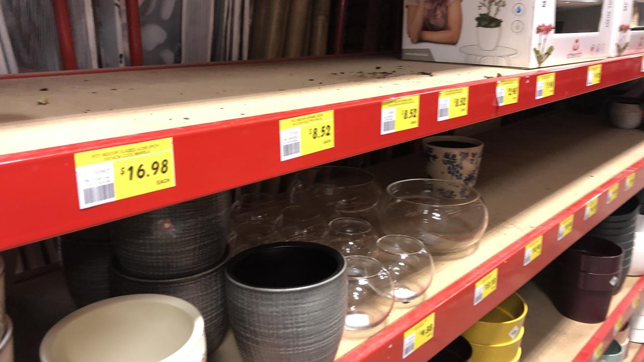 Empty shelves at Bunnings where demand has been outstripping supply for ceramic pots and plant holders.