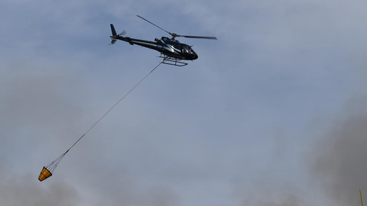 A Queensland Fire and Emergency Services spokeswoman said two fire crews and a helicopter were at the blaze on Collaroy-Killarney Rd. Picture: Zizi Averill
