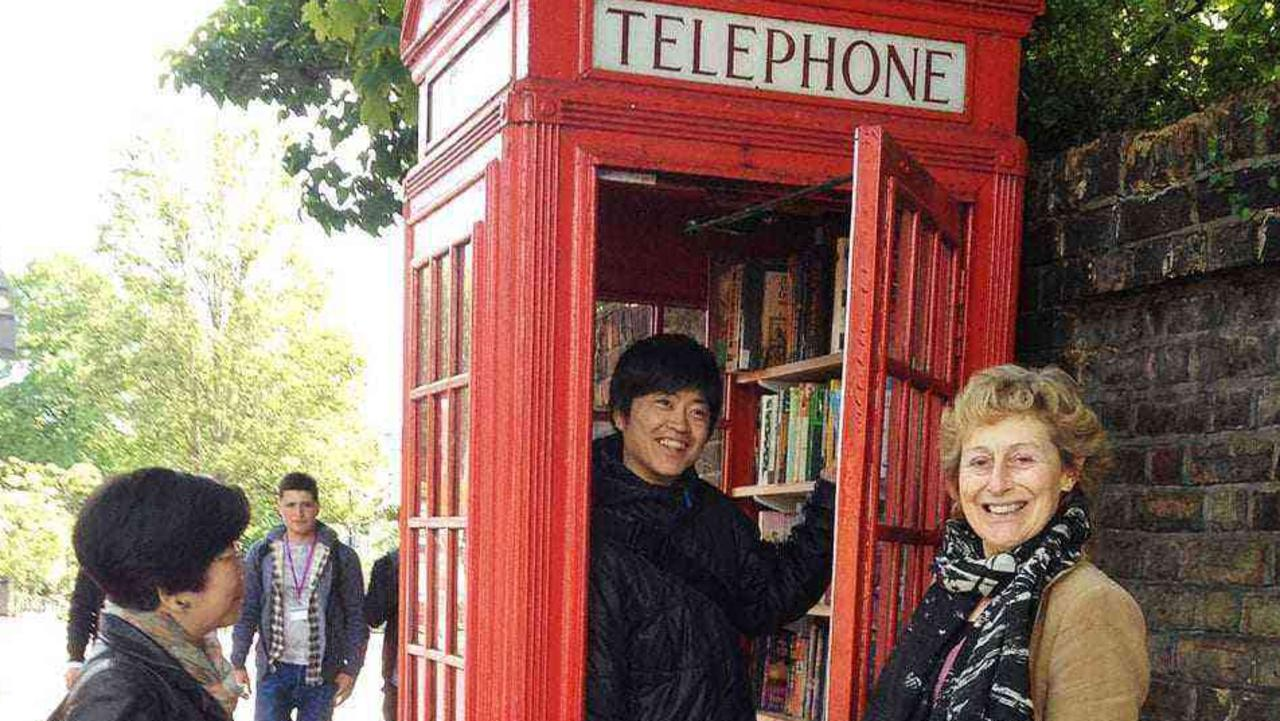 Time for a good read in the local telephone box like this one in England.