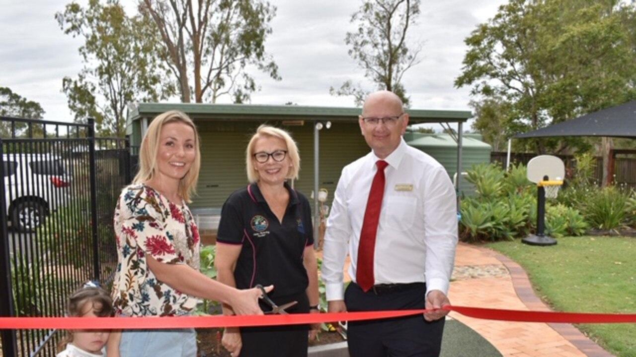 Parent's committee president Danielle Newman, teacher-director Jayne Pickering and Blair MP Shayne Neumann officially open the new facilities.
