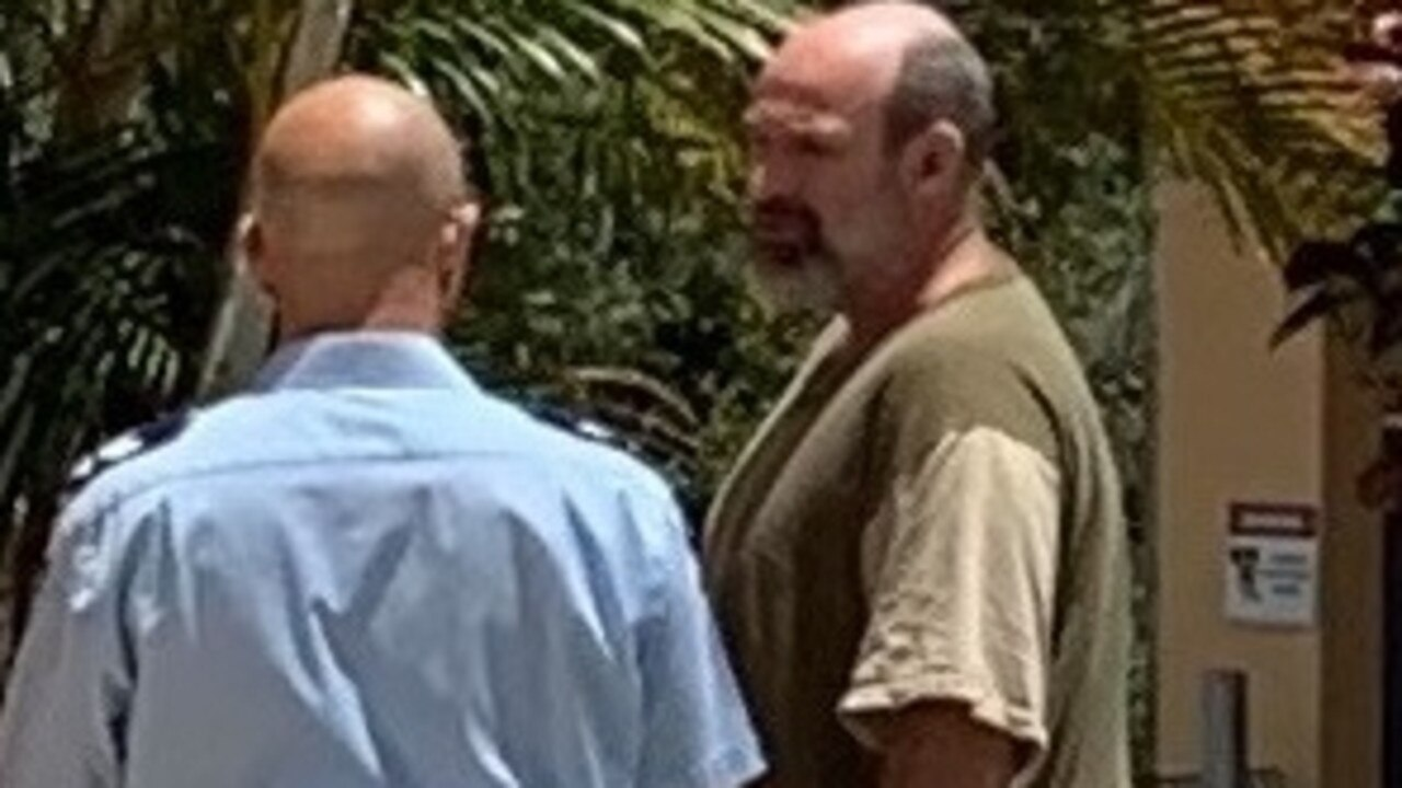 Robert MIchael Green with a police officer outside Gympie District Court, November 27, 2020