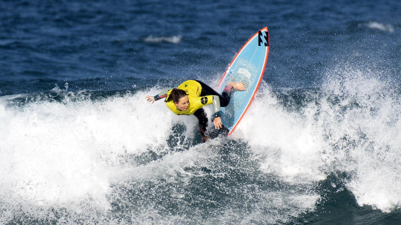 Carly Shanahan in the quarter finals of the Woolworths NSW Junior Surfing Titles in Coffs Harbour.
