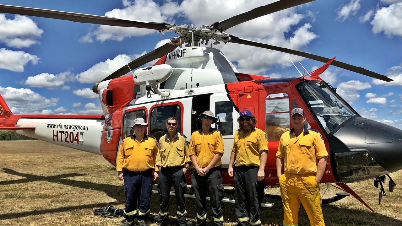 REMOTE AREA FIREFIGHTERS: The highly experienced and capable Remote Area Firefighter Team are on standby at Casino, ready to be deployed to attack and extinguish fires in areas where fire trucks can cannot access. L-R Ground support Owen Byrnes with Peter Cram, Morgan Fraser, Todd French and Brendon Smith.