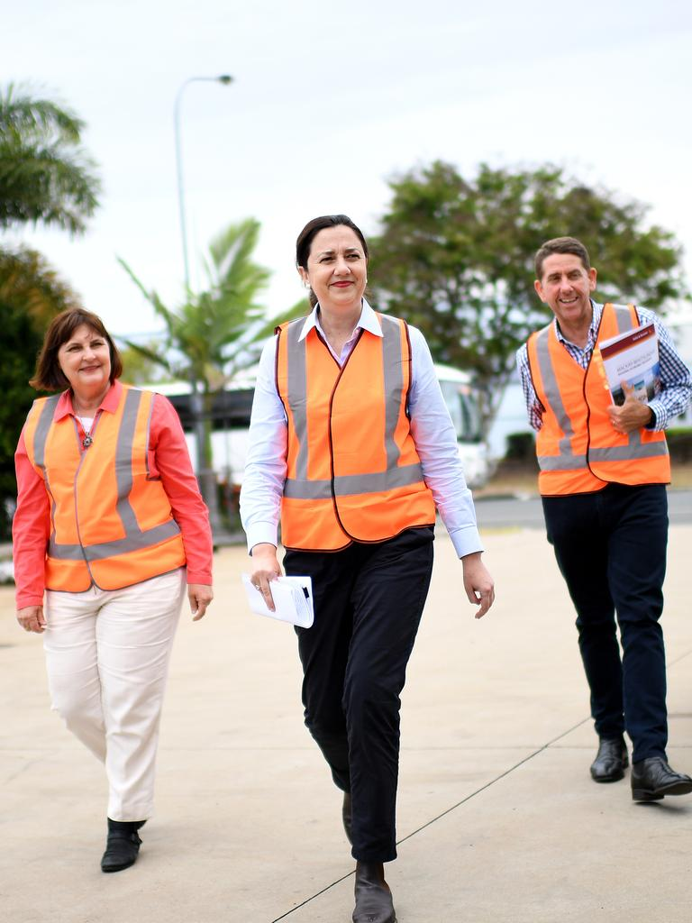 Queensland Premier Annastacia Palaszczuk (centre) arrives with Mackay MP Julieanne Gilbert and Treasurer Cameron Dick to visit De Goey Contractors (DGC). Picture: NCA NewsWire / Dan Peled