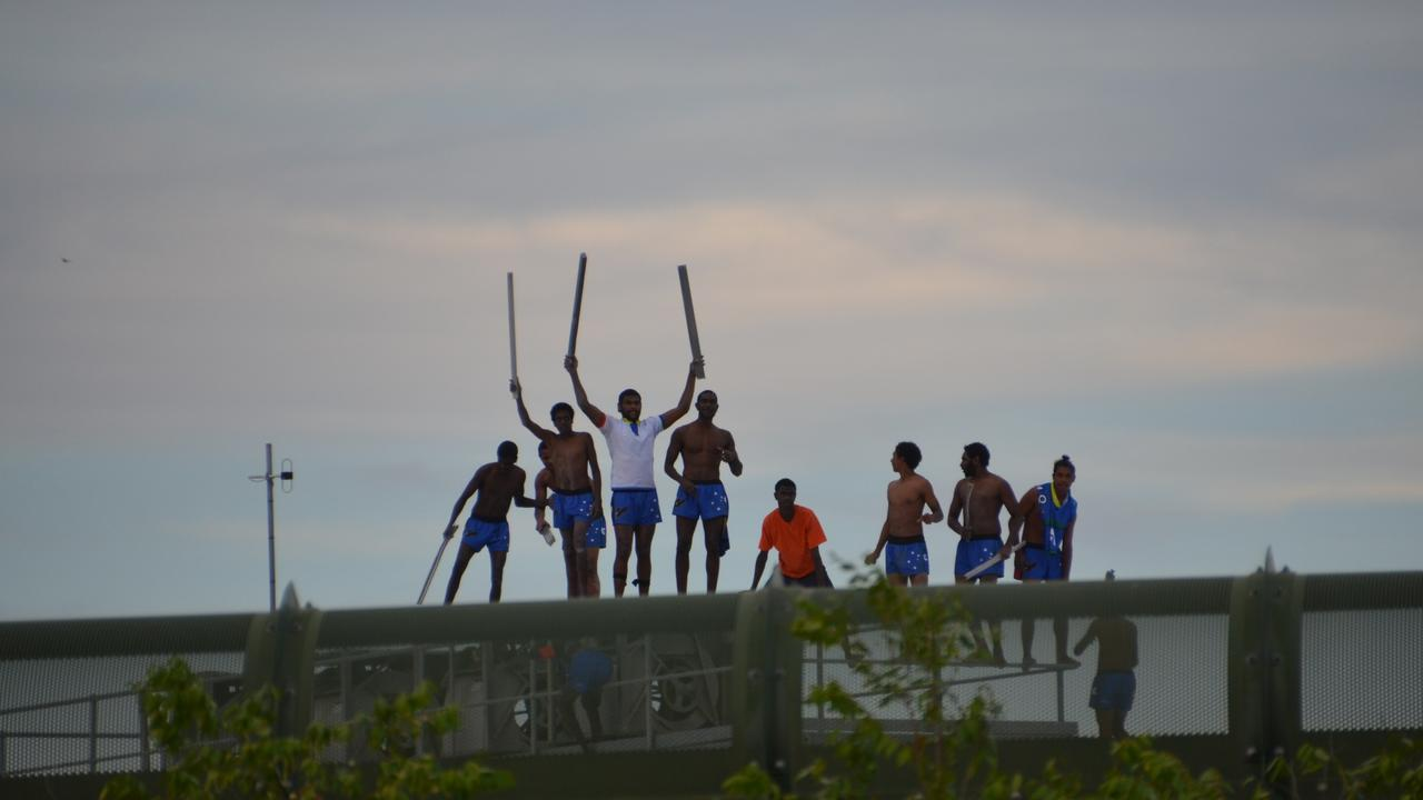 Youths rioting on top of a building at Cleveland Youth Detention Centre. Picture: DOMANII CAMERON