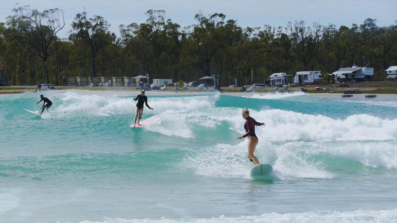 Longboarders front to back - Charlotte Lethbridge, Surf Lakes Ambassador, and Australia Junior Women's Longboard Champion, Luca Doble, Aaron Hughes.