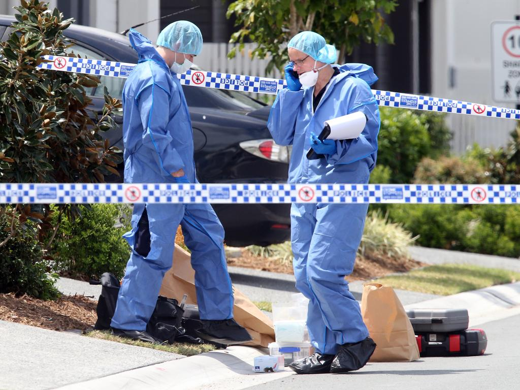 Police forensics officers investigating at the scene of Shane Bowden's killing. Picture: Richard Gosling.