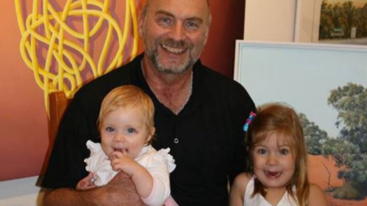 James Ainslie (with granddaughters Amelia and Lilly in 2011) suffered a heart attack during his morning walk along Noosa River on Thursday.