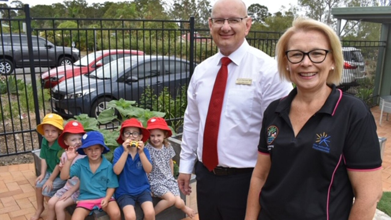 Blair MP Shayne Neumann and teacher-director Jayne Pickering with students from Yamanto Community Kindy and Pre-School, enjoying the new sensory path.