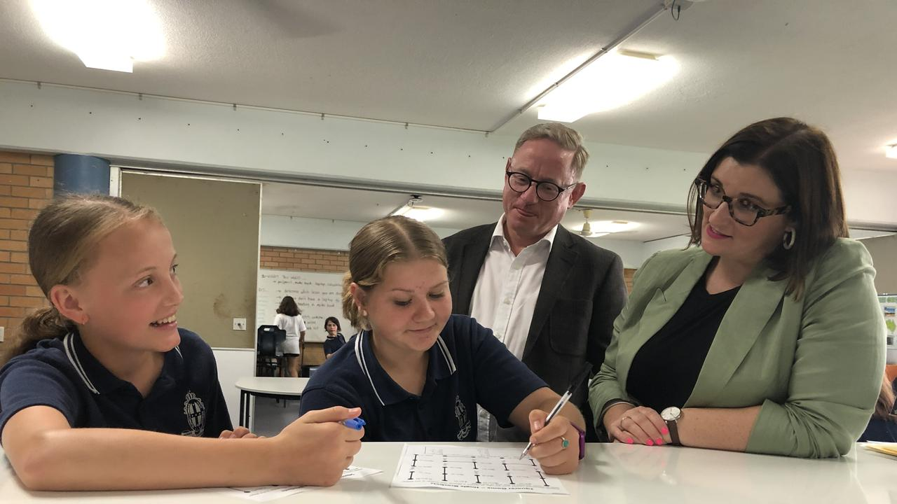 Murwillumbah High School year seven students Eva Tiffen, 12, and Jazmin Harris, 13, with Ben Franklin MLC and education Minister Sarah Mitchell. Photo: Jessica Lamb