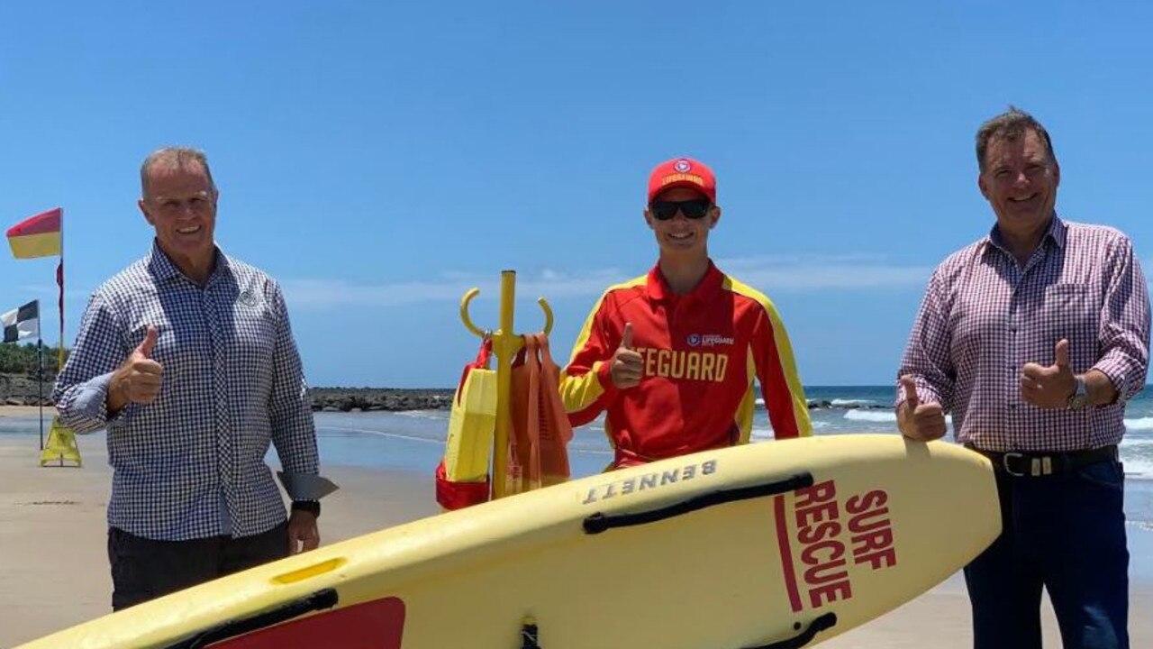 SWIM SAFE: Bundaberg Surf Life Saving Club president John McGregor, lifeguard Ky Woods and Member for Burnett Stephen Bennett urging swimmers to practice water safety while at the beach.