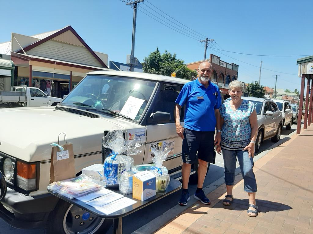 Chris and Janine Sparks prepare to draw the second of two raffles in support of Beyond Blue at Maclean, before leaving for the Beyond Blue (Beyond Bitumen) car rally through the back-roads of southern New South Wales.