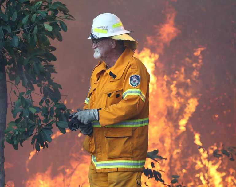 Firefighters battle bushfires in Angourie on September 10, 2019. (AAP Image/Jason O'Brien)