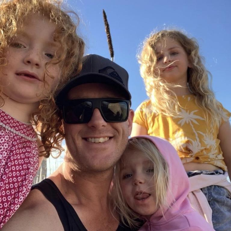 Rylee Rose Black (bottom right) with her biological father, who is not accused of any wrongdoing, and her sisters.