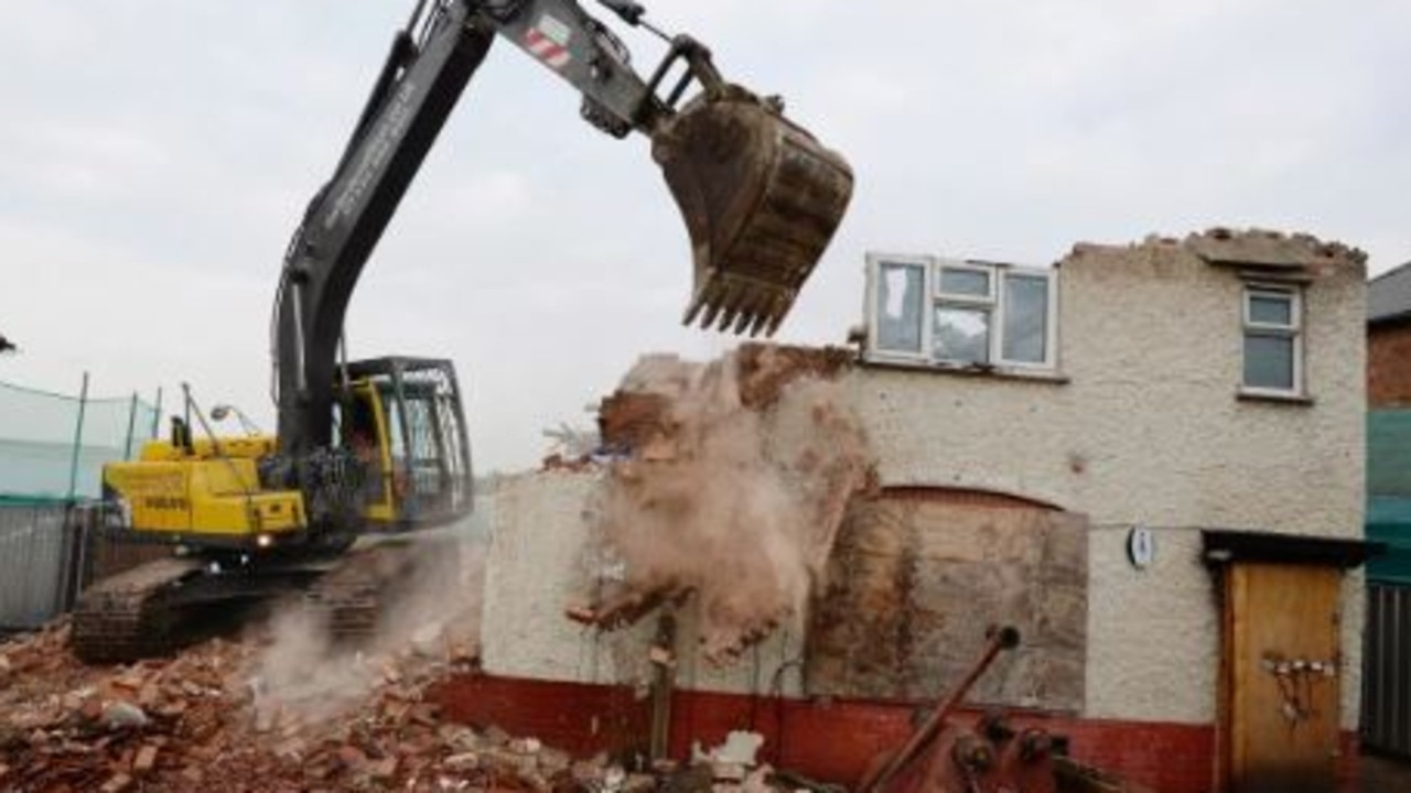 Builders later demolished the property. Picture: Getty Images