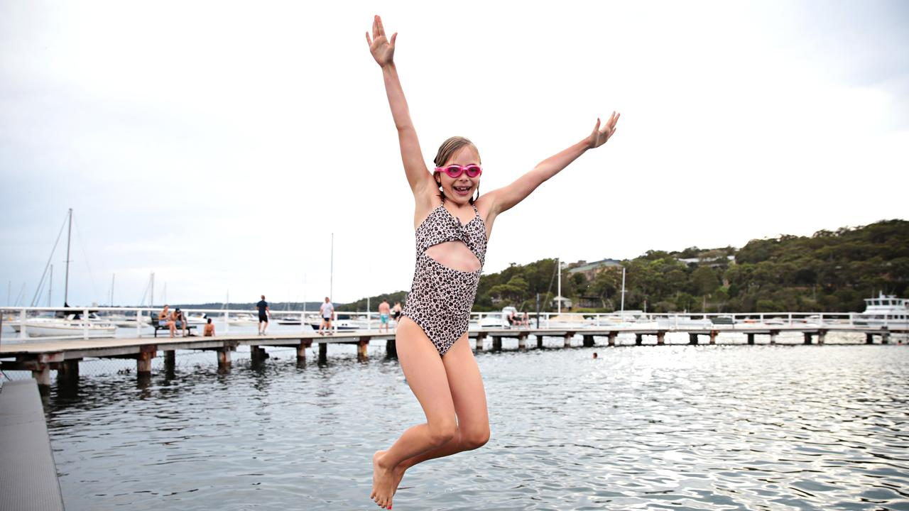 Chloe Brown, 8, went down to Balmoral Beach for an early morning swim with her mother Saskia. Picture: Adam Yip