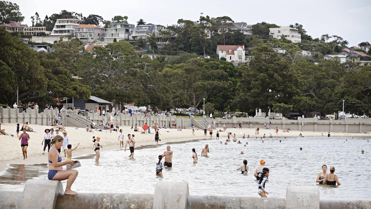 Sydneysiders beat the heat by going for an early morning dip. Balmoral was busy by 7am. Picture: Adam Yip