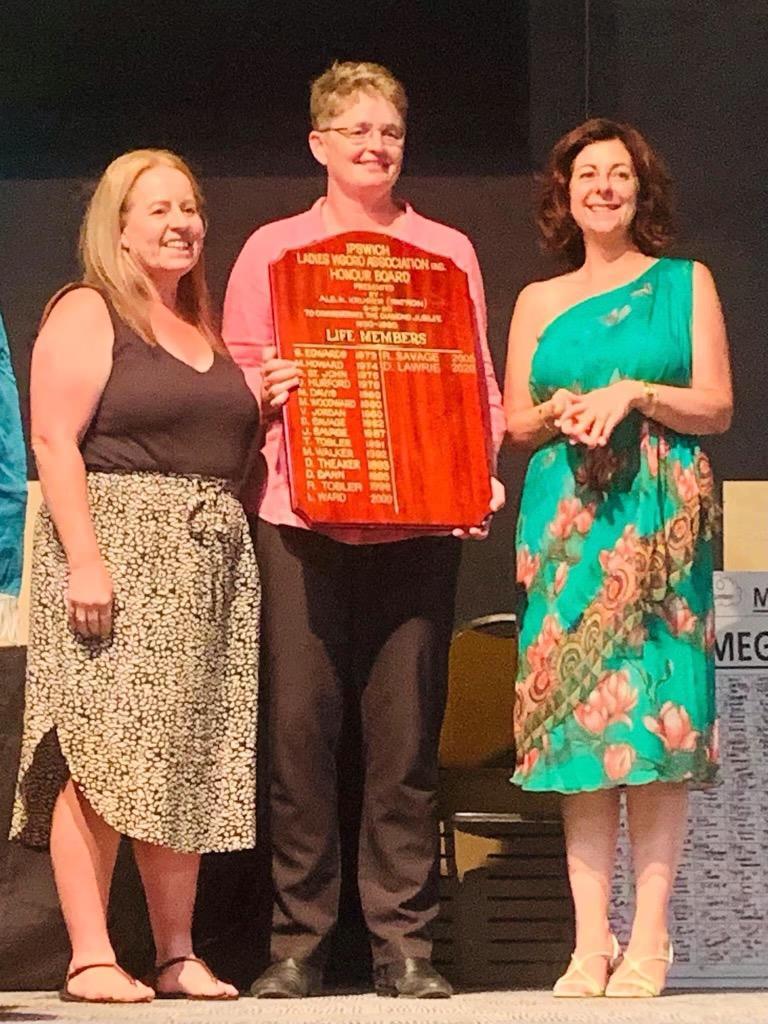 Ipswich Vigoro Association president Deanne Lawrie receives her life membership from previous life member Rachel Savage and Member for Ipswich Jennifer Howard.