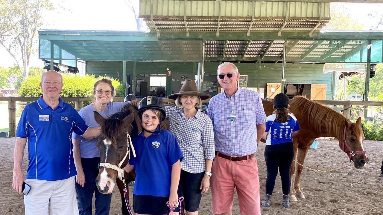 Rotarian Leo Smith, school chaplain Linda Sutton, Ellie the horse, student Mae, Helen Sorensen and rotarian James Macready. Picture: Graham Lukins