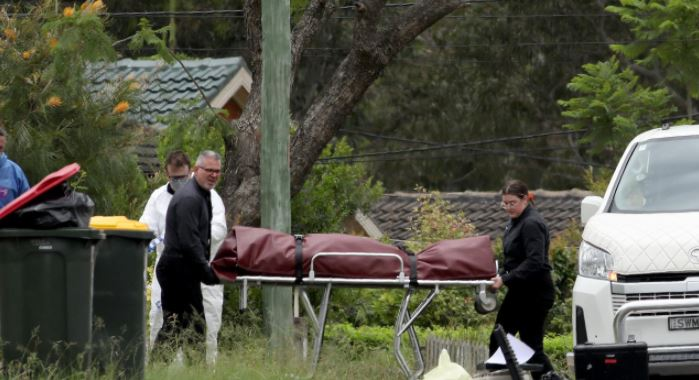 A body is removed from a Tregear home on Monday. Picture: NCA NewsWire / Damian Shaw