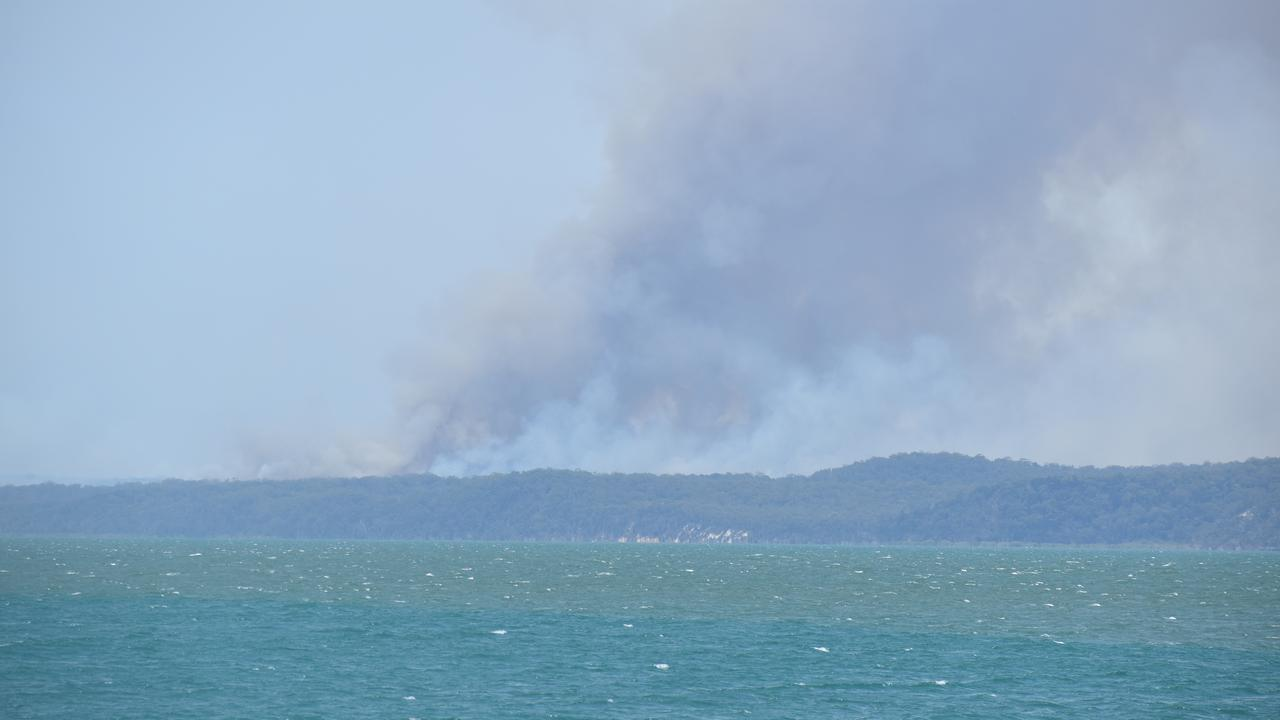 Black smoke rises over Fraser Island. Photo: Stuart Fast