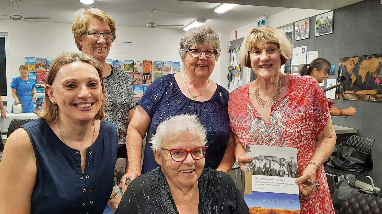 Kerrie Deasy, Theresa Silvester, Desley Barlow, Carole Murray and Maree Ganley with a copy of her book into the history into the St Ursula's boarding community