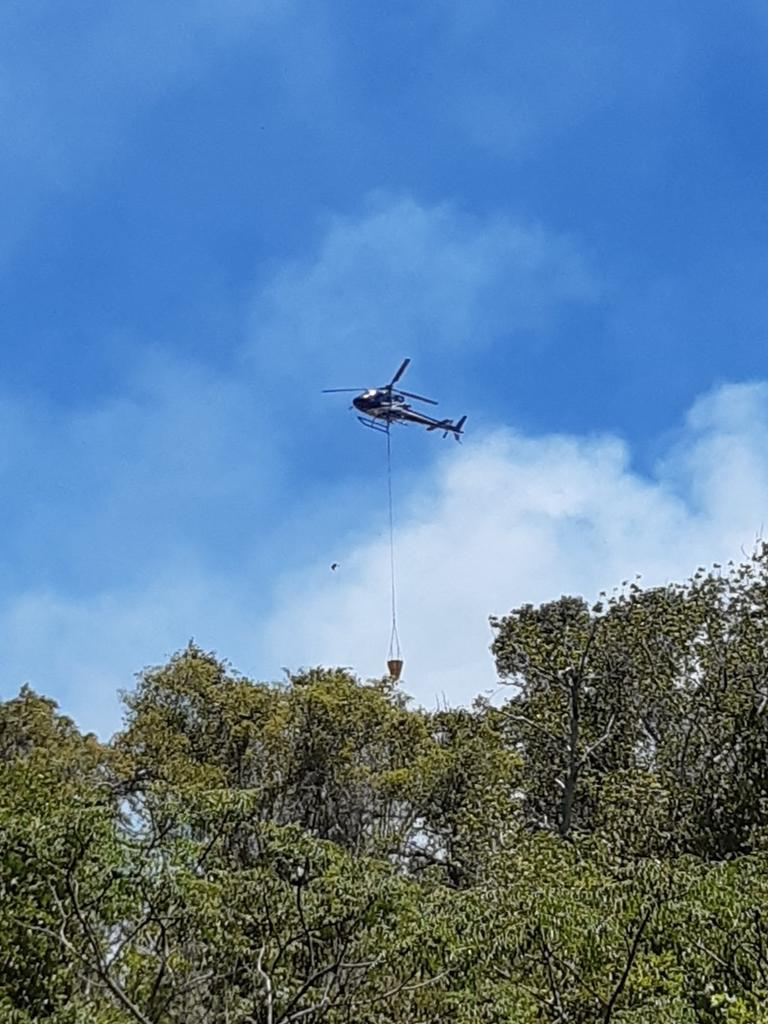 Queensland Rural Fire Service crews as well as a Firebird are fighting a bushfire at Mount Jukes near Seaforth. Picture: Kevin Petith