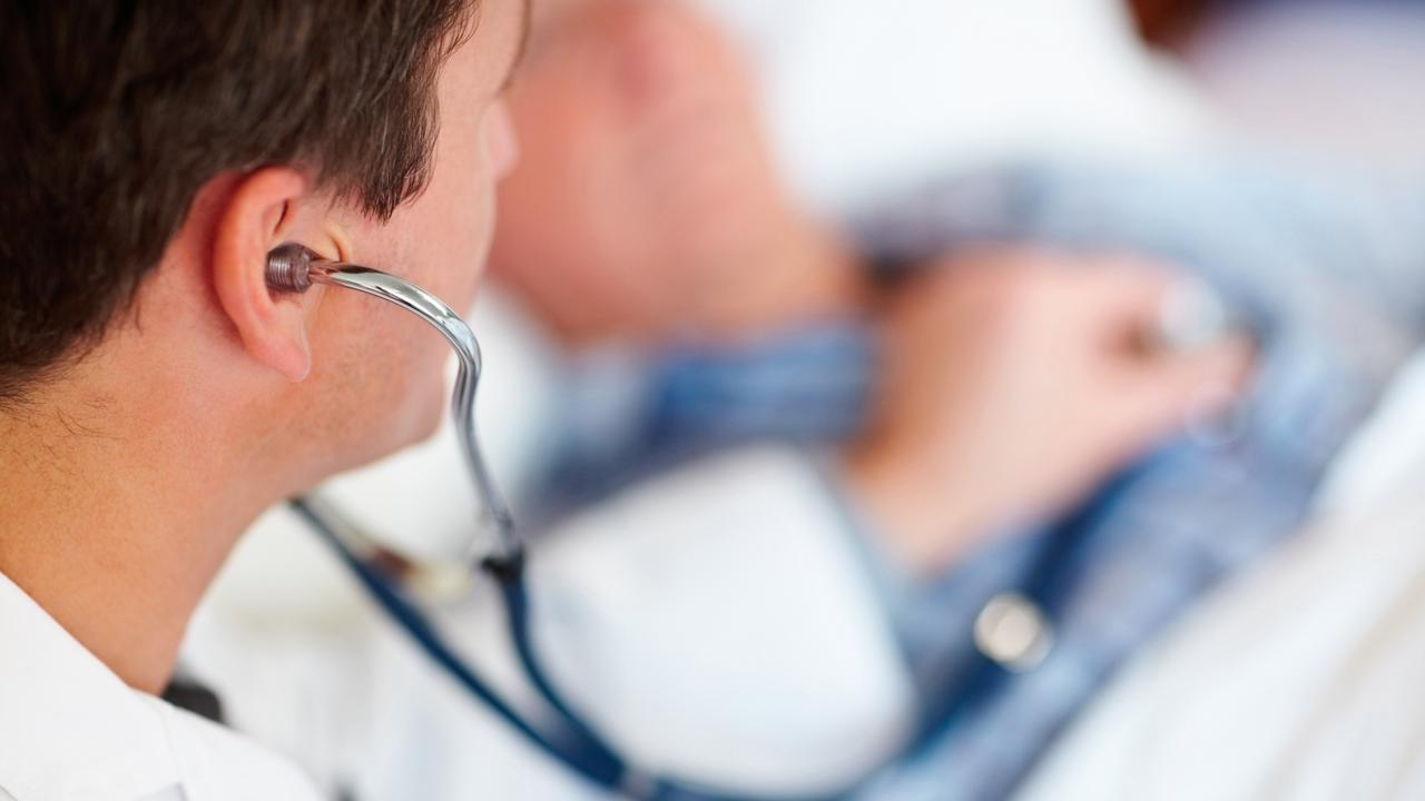 A doctor examining a patient's heart beat with a stethoscope. Photo: File