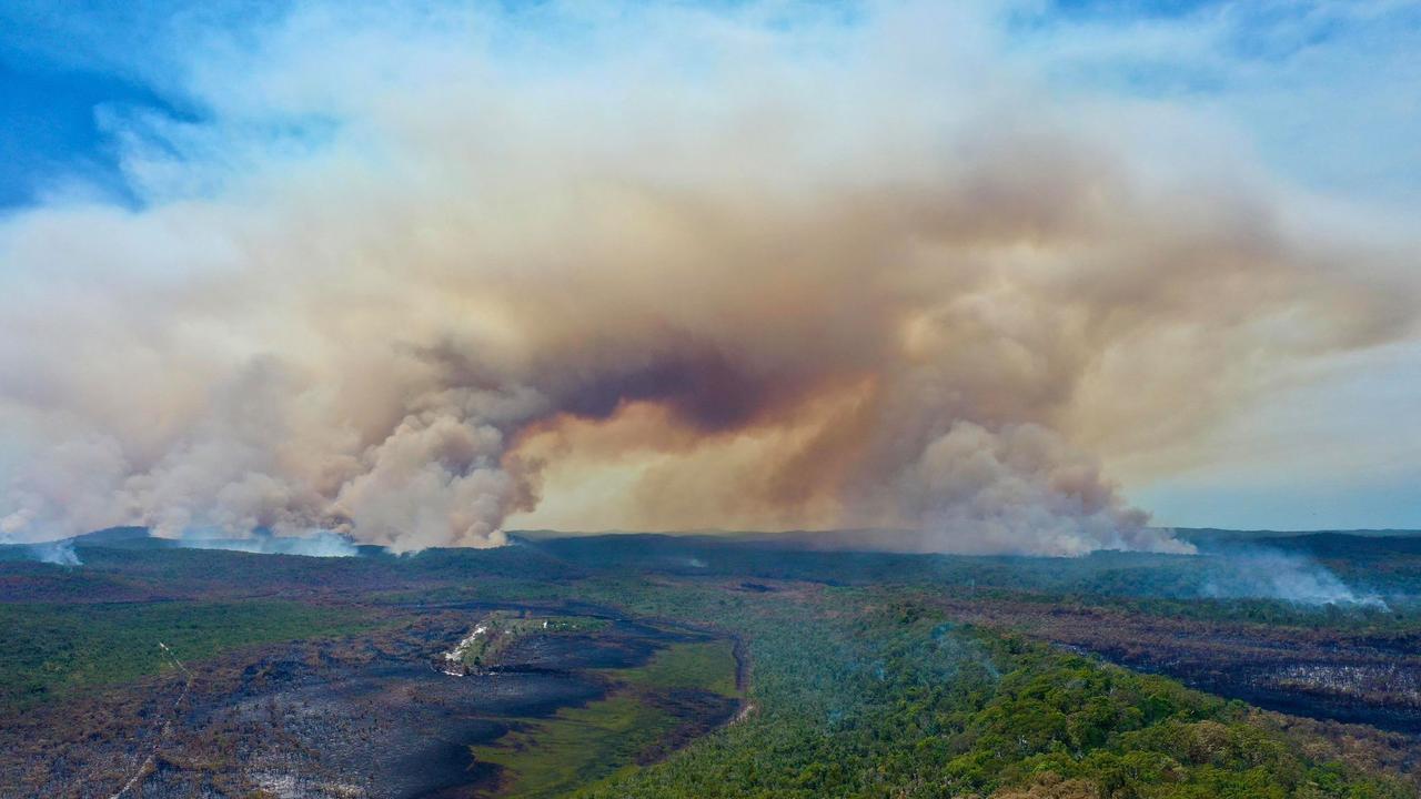 Drone stills taken by Glen Winney of the fire burning on Fraser Island. Picture: Glen Winney