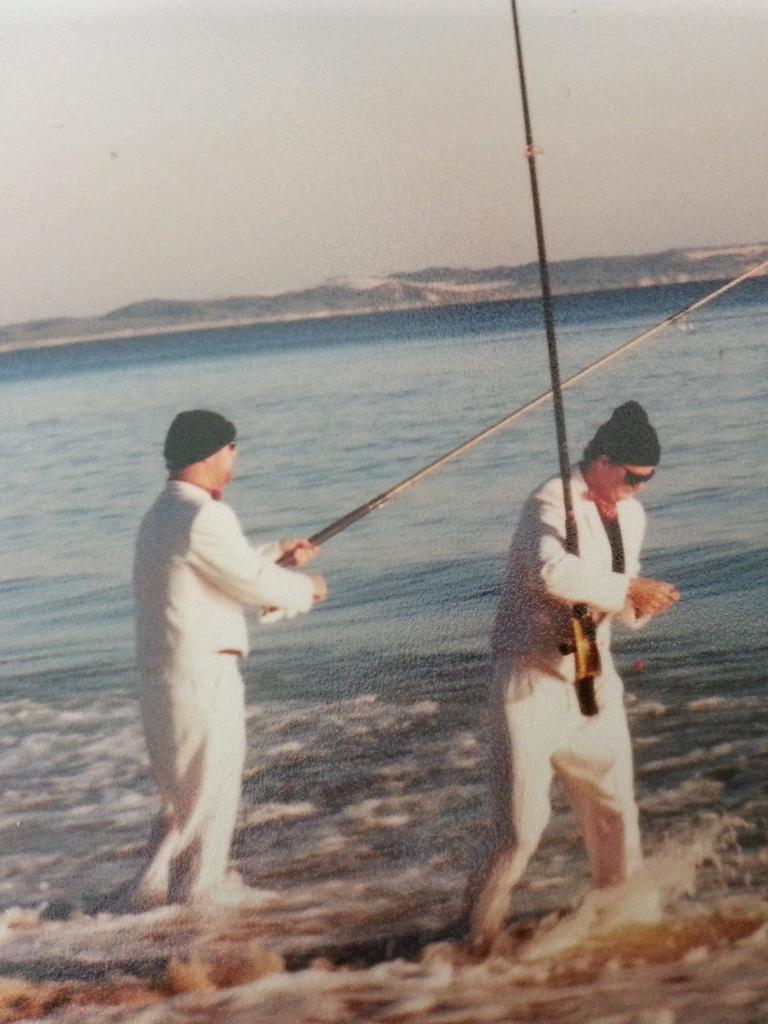 Wade and Rick, with pilchards in their pockets, keep fishing. Picture: David Lems